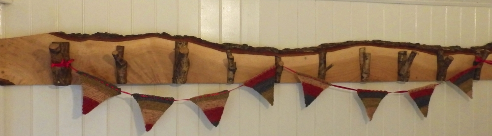 A panel of oak hooks with bunting.