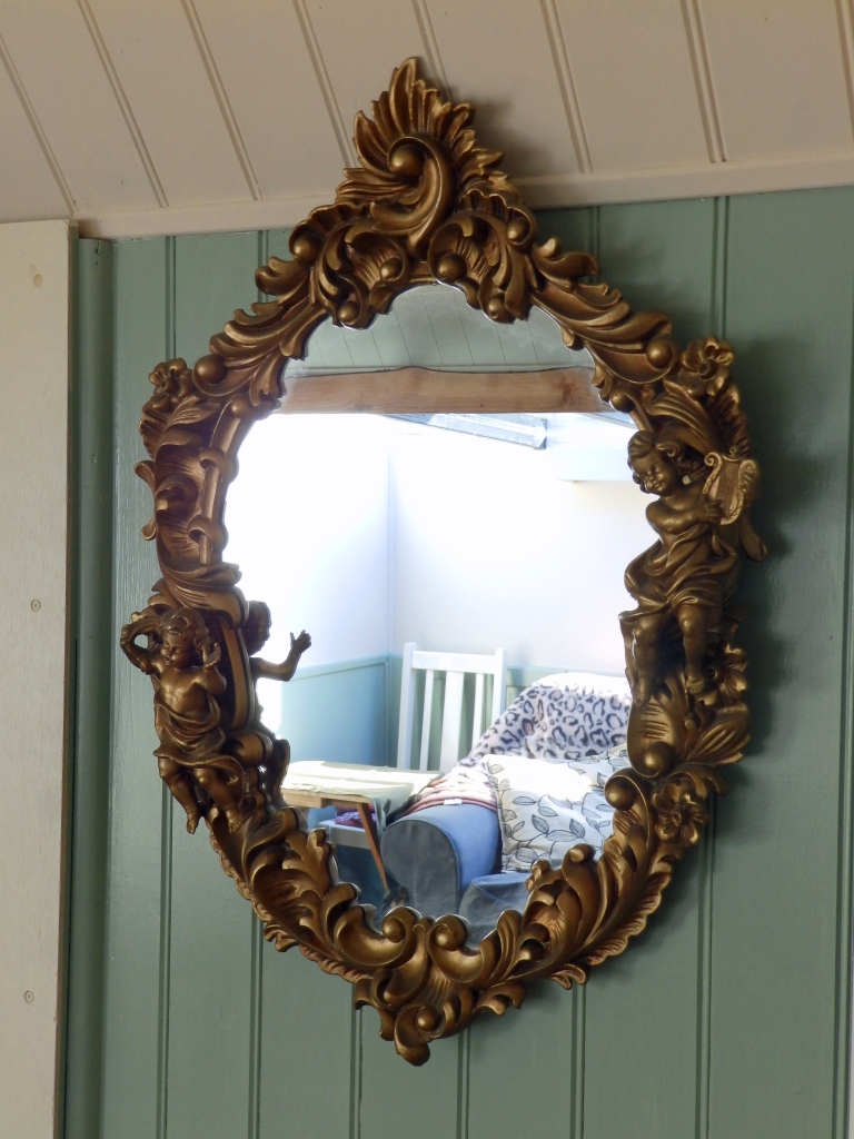 The ornate lounge mirror