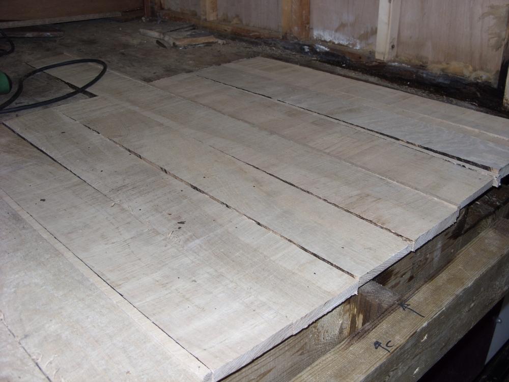 Floorboard repairs in the bedroom.