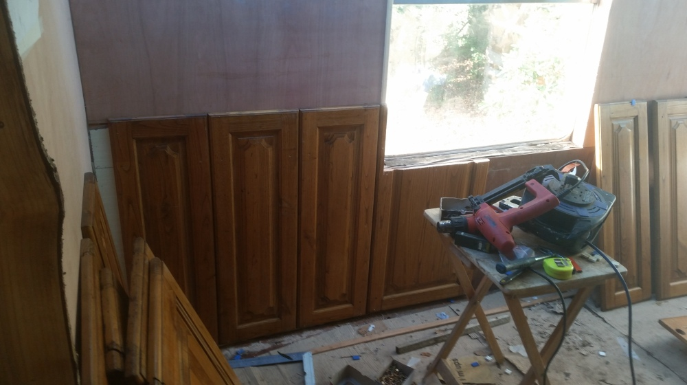 Upcycled oak panels form the pull-out extension walls