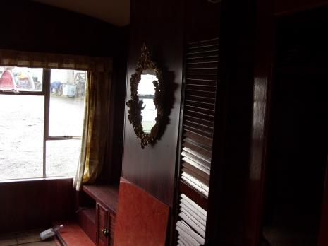 The dark wood of the original lounge